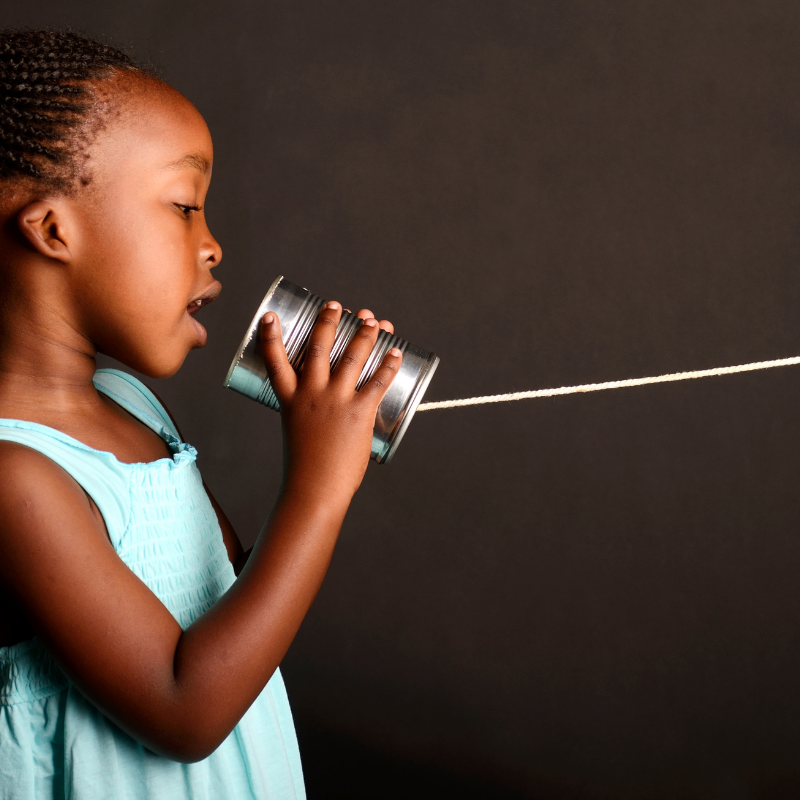 Girl with can and string phone
