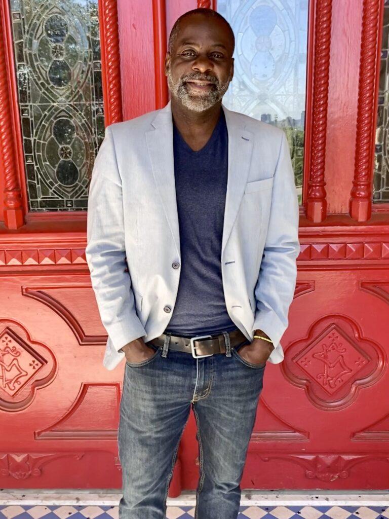 Giles in Blazer in front of red door